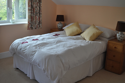 One of the doub;e en-suite bedrooms at Honeymead Farmhouse large country house available to hire on Exmoor
