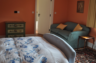 One of the double-ensuite bedroooms at Honeymead Farmhouse large country house available to hire on Exmoor
