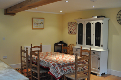 The dining table in the large farmhouse kitchen at Honeymead Farmhouse large country house available to hire on Exmoor