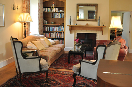 One of the many reception rooms at Honeymead Farmhouse large country house available to hire on Exmoor