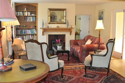 One of the reception rooms at Honeymead Farmhouse large country house available to hire on Exmoor